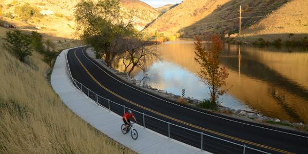 person riding bike around lake